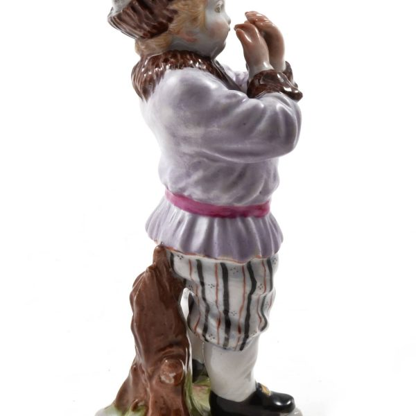 Meissen Porcelain, Hand Painted Meissen Porcelain Figurine of a Boy with a Hat. Meissen Porcelain Germany. 20th Century